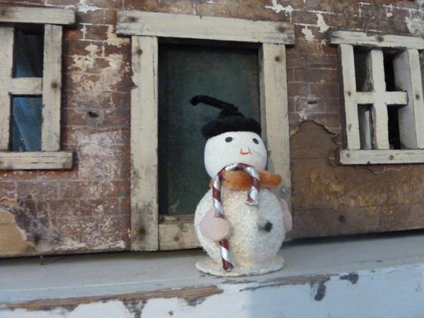 snow man old house